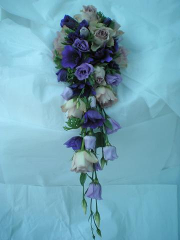 Brompton Floral Designs Wedding Flowers Central London UK NW4  - A shower bouquet using Purple Anemones, Lisianthus and Cool Water Lilac Rose.
